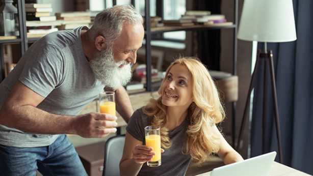 older couple drinking orange juice to prevent hip fracture