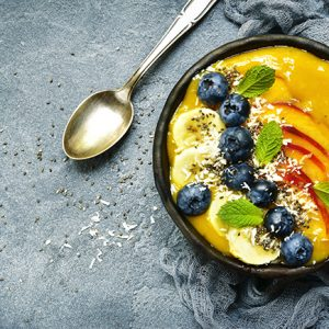 organic orange mango turmeric smoothie bowl